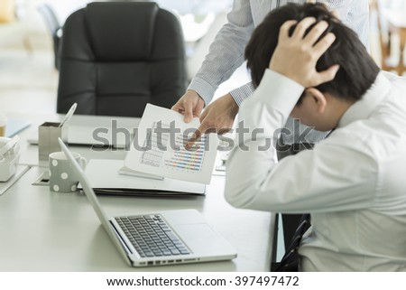 Businessmen confirming a document - stock photo