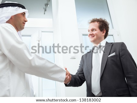 Businessmen congratulating each other's business success. - stock photo
