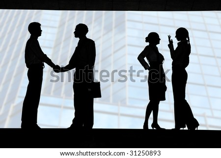 Businessmen congratulating each other with successful deal while two ladies talking behind