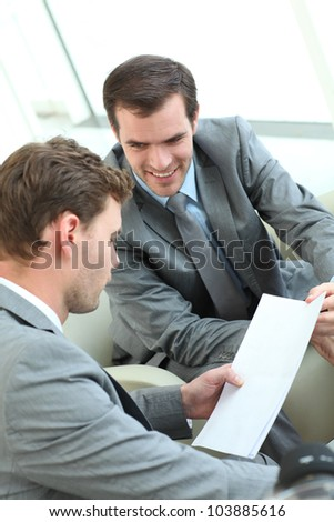 Businessmen discussing conditions of contract