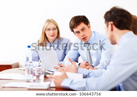 Businessmen discussing in the office - stock photo