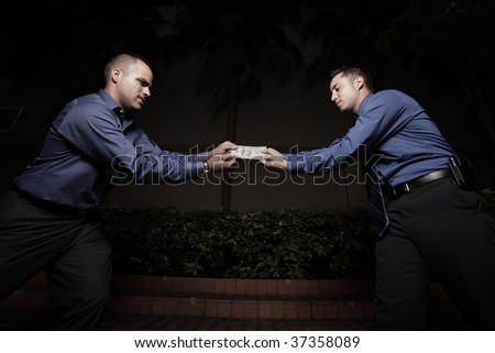 Businessmen fighting over a one hundred dollar bill