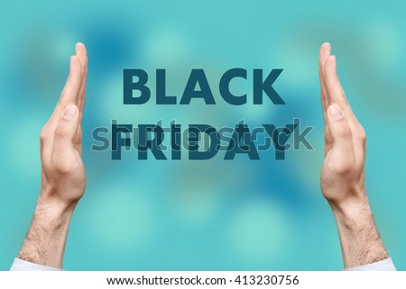 "Businessmen from both hands "" BLACK FRIDAY "" writes - stock photo"