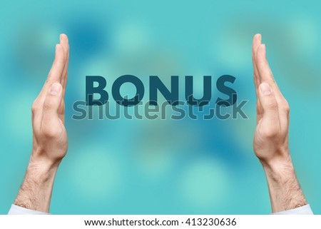 "Businessmen from both hands "" BONUS "" writes - stock photo"