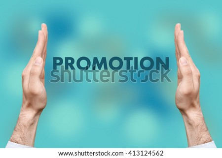 """Businessmen from both hands """" PROMOTION """" writes - stock photo"""