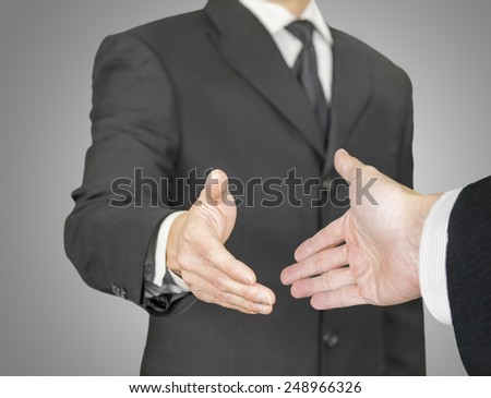 Businessmen having a handshake, point of view composition - stock photo