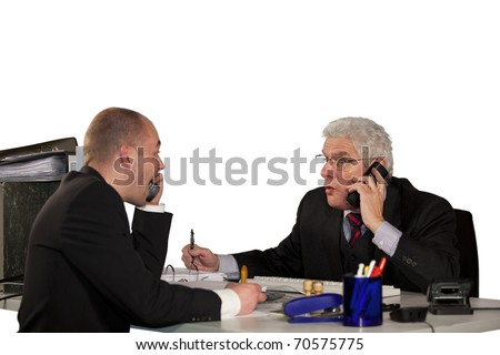 businessmen having a heavy discussion on a telephone conference