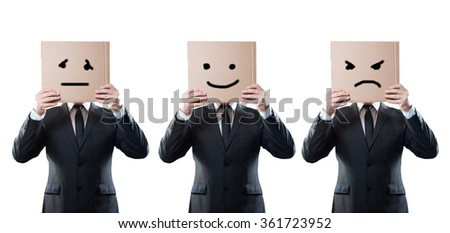 businessmen holding a card with emotional face on white background. Clipping path - stock photo