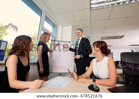 Businessmen in a good mood, laughing, smiling, success, signing of the contract. Group of business partners to discuss, speak at the meeting.