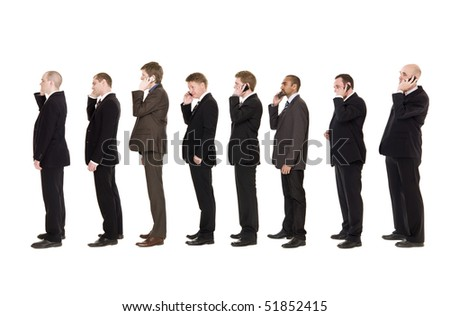 Businessmen in a line using their cellphones - stock photo