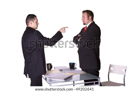 Businessmen in an Office Fighting and Pointing Fingers at Each Other - Isolated Background - stock photo