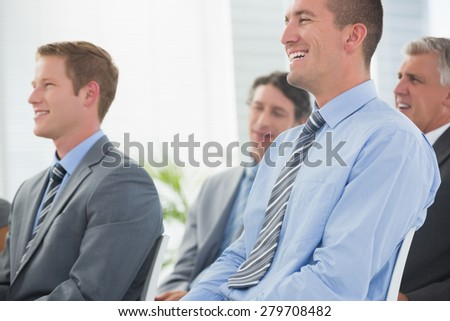 Businessmen listening conference presentation in meeting room - stock photo