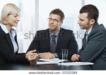 Businessmen listening to businesswoman explaining work at office meeting.? - stock photo