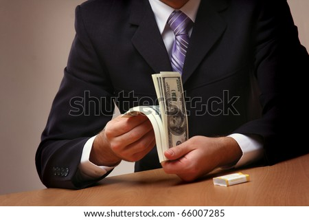 Businessmen passing money with contrac - stock photo