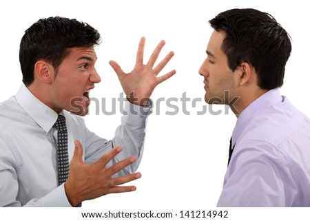 Businessmen quarreling - stock photo