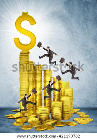 Businessmen run and jump on money stairs  to dollar sign on top