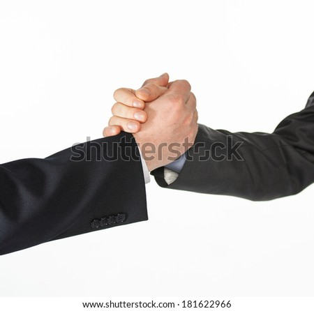 Businessmen shaking hands - closeup shot on white background