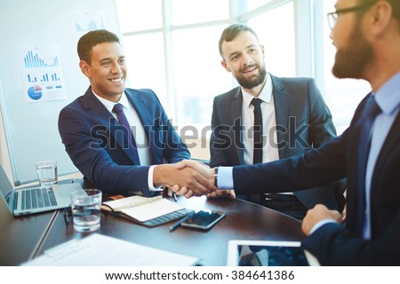 Businessmen shaking hands during a meeting