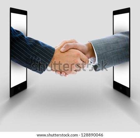 Businessmen shaking hands from digital tablets on white background