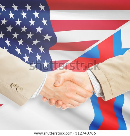Businessmen shaking hands - United States and Faroe Islands