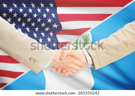 Businessmen shaking hands - United States and Guatemala