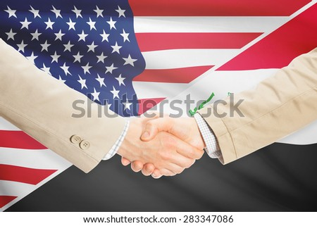 Businessmen shaking hands - United States and Iraq
