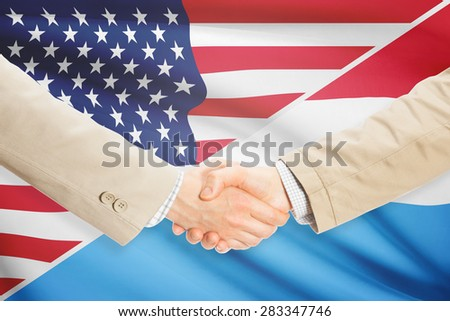 Businessmen shaking hands - United States and Luxembourg