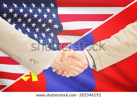 Businessmen shaking hands - United States and Mongolia