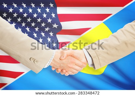 Businessmen shaking hands - United States and Palau