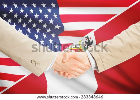 Businessmen shaking hands - United States and Peru