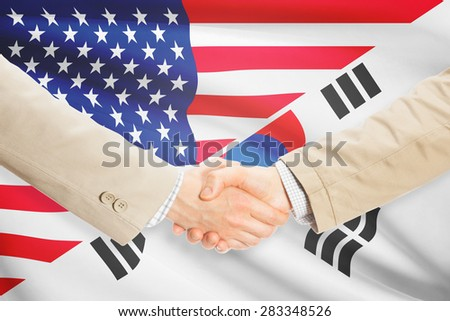 Businessmen shaking hands - United States and South Korea