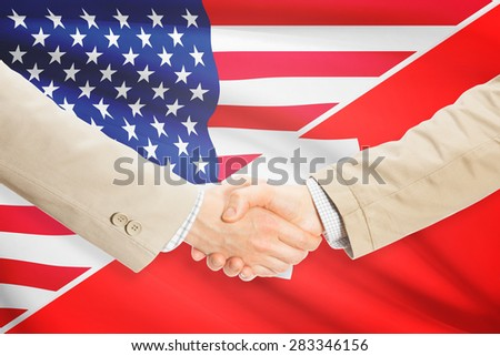 Businessmen shaking hands - United States and Switzerland
