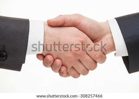 Businessmen shaking hands, white background