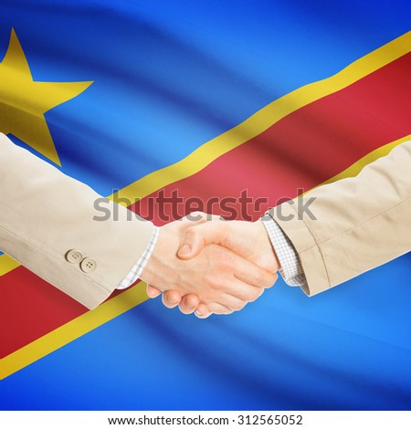 Businessmen shaking hands with flag on background - Democratic Republic of the Congo - Congo-Kinshasa - stock photo