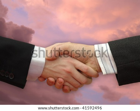 Businessmen shaking hands with the dramatically Sky