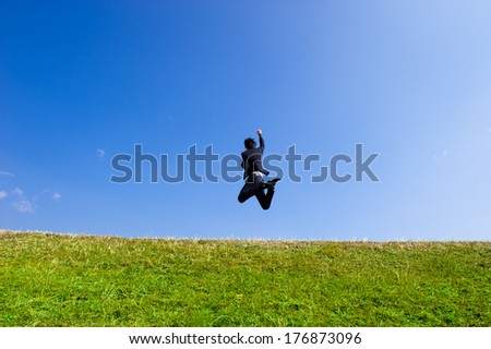 Businessmen suit to jump high into the sky blue sky