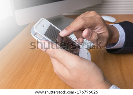 businessmen using phone in office