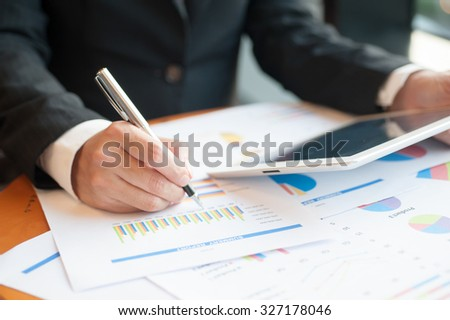 businessmen using tablet and writing business plan for meeting preparation in office. - stock photo