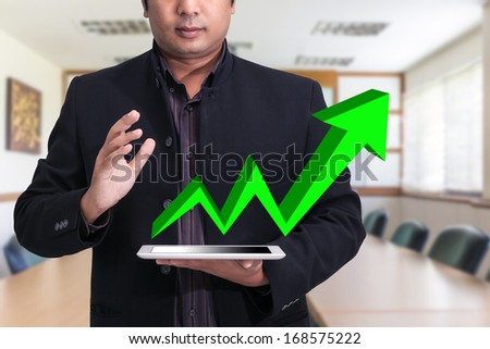 businessmen using touchpad at meeting - stock photo