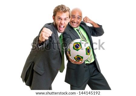 Businessmen with Brazilian flag soccer ball posing - stock photo