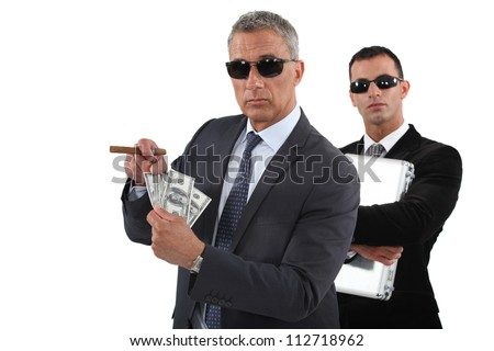 Businessmen with cash - stock photo