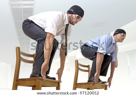 Businessmen with swimming gear ready to dive - stock photo