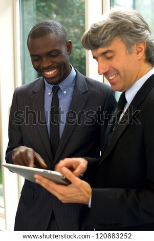 businessmen with tablet - stock photo