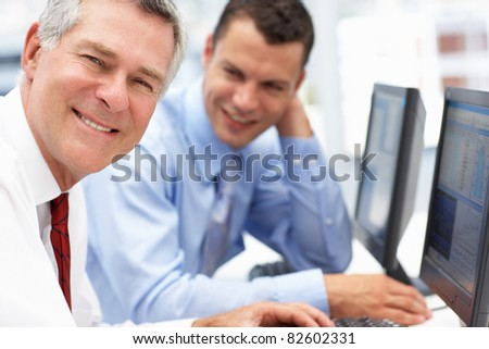Businessmen working on computers