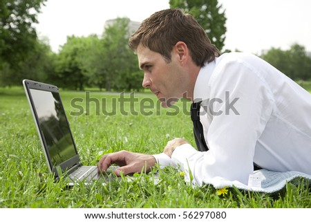 businessmen working on laptop outdoor
