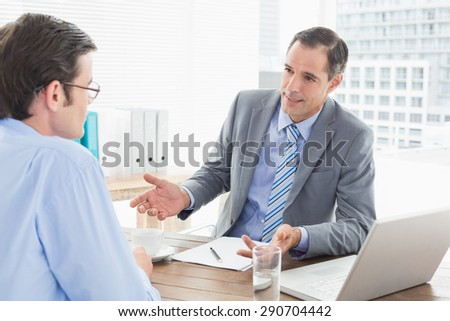 Businessmen working together in an office
