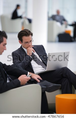 Businessmen working with laptop computer at a seminar
