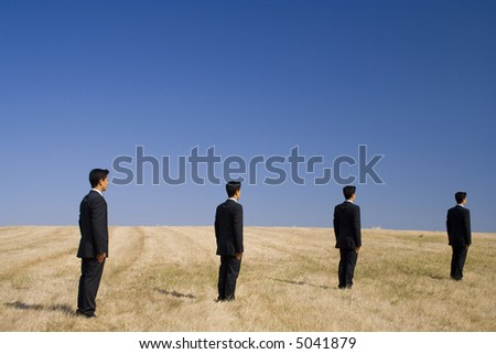 businessmens follow a path to the future - stock photo