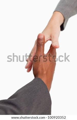 Businesspeople are going to shake-hands - stock photo