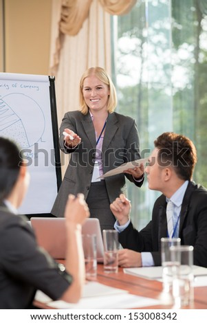 Businesspeople discussing strategy together at the meeting - stock photo